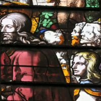 Fig. 20. King's College Chapel, Cambridge, detail from Window 8.4. Christ's entry into Jerusalem. Head of Christ and golden-haired man behind him are by Hedgeland. Photo: A. Phippen, reproduced by the kind permission of the Provost and Scholars of King's College Cambridge.